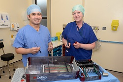 Charge Nurse Francis Millan and Healthcare Assistant Jodie Insley with the tools